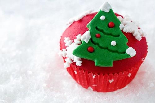 Christmas cake or cupcakes with a Christmas tree on top