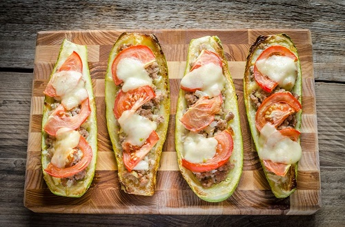 Zucchini stuffed with mozzarella cheese and tomatoes