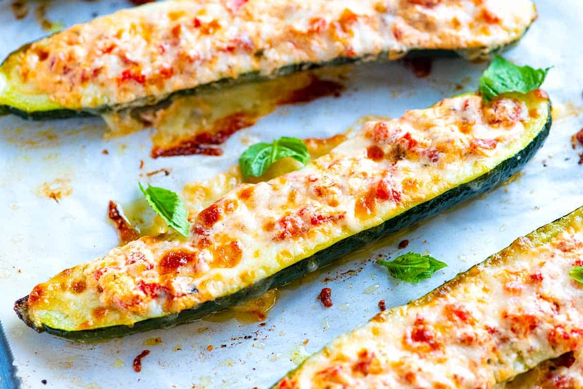 Zucchini stuffed with mozzarella cheese and tomatoes